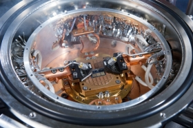 High-speed silicon-germanium chips and measurements probes can be seen inside a cryogenic probe station in a laboratory at the Georgia Institute of Technology. (Georgia Tech Photo: Rob Felt)