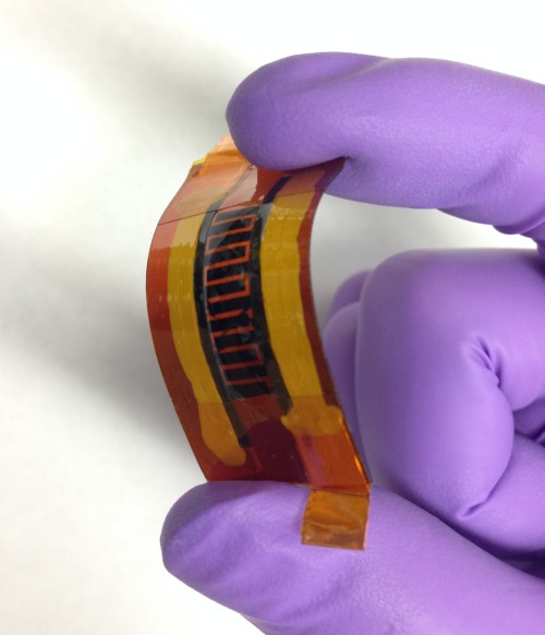 "Rice University scientists made this supercapacitor with interlocked ""fingers"" using a laser and writing the pattern into a boron-infused sheet of polyimide. The device may be suitable for flexible, wearable electronics. (Source: Tour Group/Rice University)"