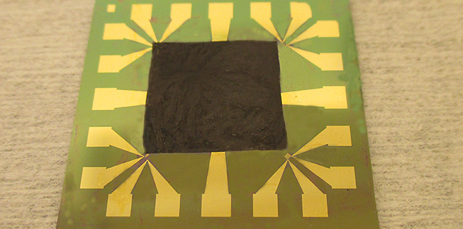 Graphene-based film on an electronic component with high heat intensity. (Source: Johan Liu / Chalmers University of Technology)