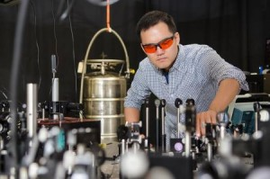 David Hsieh directs the path of a laser beam through an apparatus, which is used to measure spontaneous self-organization of electrons inside a crystal. (Source: Caltech)