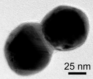 This electron microscope image shows a dimer of silver plated gold nanoparticles. A layer of silver connects the particles. (Source: C. Byers/Rice University)