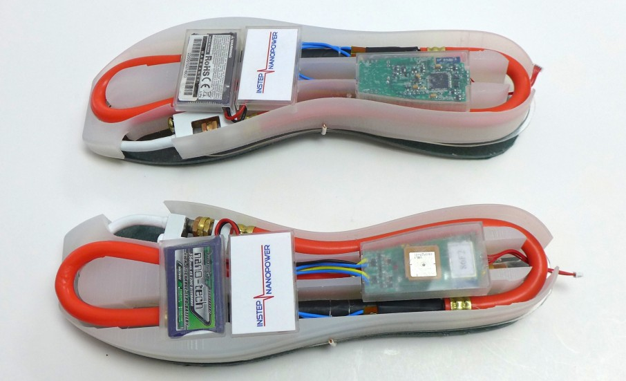 Upside-down shoe soles with an energy harvester, battery and electronics suite integrated into each sole. The harvester directly powers the electronics suite. (Source: UW–Madison College of Engineering)