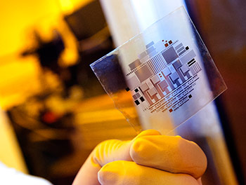 A circuit made from organic thin-film transistors is fabricated on a flexible plastic substrate. (Source: Patrick Mansell/Penn State)