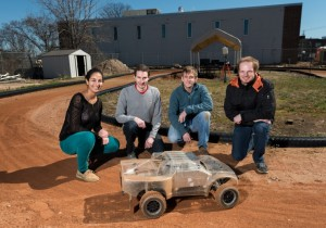 Georgia Tech researchers are using an electric-powered autonomous vehicle to help driverless vehicles maintain control at the edge of their handling limits. Shown (l-r) are Georgia Tech students Sarah Selim, Brian Goldfain, Paul Drews, Grady Williams. (Source: Georgia Tech)