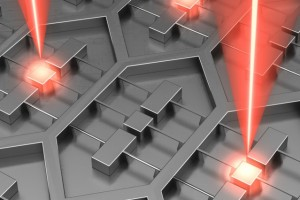 "Researchers at MIT and Sandia National Laboratories have designed a device that is an array of 37 microfabricated lasers on a single chip. Its power requirements are relatively low because the radiation emitted by all of the lasers is ""phase locked,"" meaning that the troughs and crests of its waves are perfectly aligned. (Source: MIT, Sandia National Laboratories)"