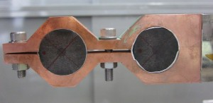 Sample holder for split-coil PFM experiments with two of the Bulk Superconductivity Group's Gd-Ba-Cu-O bulk high-temperature superconductors. (Source: University of Cambridge)