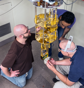 Researchers work on the SET unit. (Source: NIST)