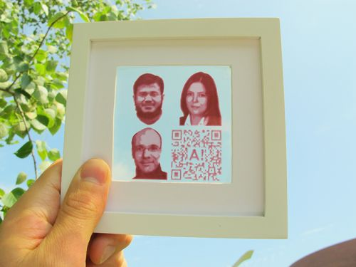 A semi-transparent dye-sensitized solar cell with inkjet-printed photovoltaic portraits of the Aalto researchers (Ghufran Hashmi, Merve Özkan, Janne Halme) and a QR code that links to the original research paper. (Source: Aalto University)