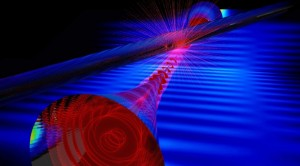 Nanofiber evanescent light (red) entering probe fiber (larger glass cylinder). (Credit: E. Edwards)