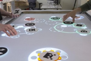 Coasters can be moved along TuneTable's projection surface to make music using elements of computer programming (Source: Georgia Tech)