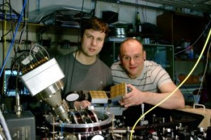 Dr Bjorn Lekitsch (left) and Prof Winfried Hensinger behind a quantum computer prototype at the University of Sussex. (Source: University of Sussex)