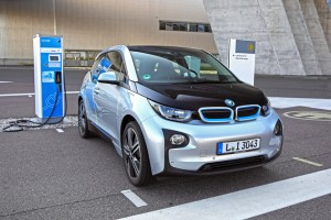 Leipzig, Germany - August 4th, 2015: Zero emission BMW i3 vehicle parked on the electric charging point near to the entry to the BMW factory. The BMW i3 was debut in 2013. The car body of this vehicle is constructed with carbon fiber, aluminium and special plastic. That's why the BMW i3 is very light with compare with rivals.